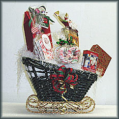Santa's Holiday Sleigh - Christmas box of nuts, peppermint bark, double chocolate cocoa, Santa snack mix, Godiva chocolates and Christmas pretzels.